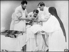 Dr Eugene-Louis Doyen operates on conjoined twins in 1902