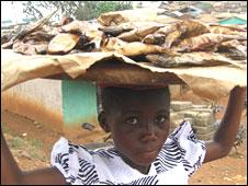 Girl selling fish
