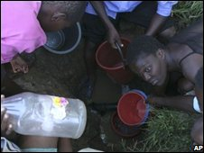 Zimbabweans wait to collect water  in Harare