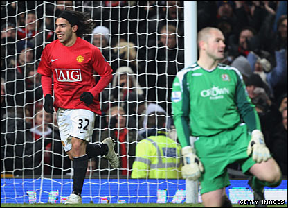 Carlos Tevez celebrates United's fourth goal