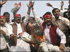 Supporters of the Socialist Party burn an effigy of a 'terrorist' in Allahabad