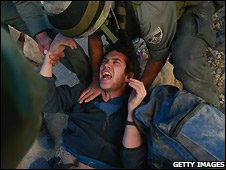 Israeli soldiers evict a Jewish settler from the Hebron house - 4/12/2008