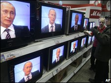 Putin on TV in Moscow shop