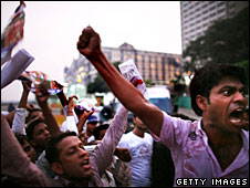People in Mumbai shout anti-Pakistani slogans at a protest near the Taj Mahal hotel, 3 December 2008