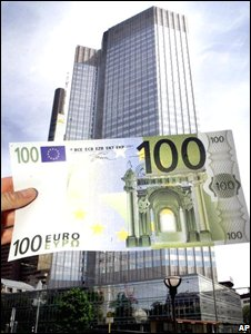An oversized 100 euro banknote is held in front of the headquarter of the European Central Bank in Frankfurt