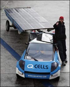 Swiss adventurer Louis Palmer beside his solar taxi in Hamburg 21/11/2008