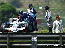 Jenson Button walks away from his abandoned car at the Brazilian Grand Prix - Honda's last in F1