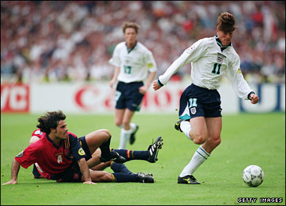 Anderton skips away from two Spanish defenders at Euro 96