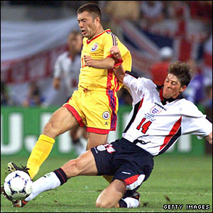 Anderton tackles Romania forward Adrian Ilie
