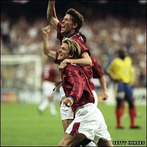 Anderton and David Beckham celebrate