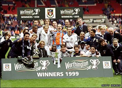 Tottenham celebrate winning the Worthington Cup in 1999 - Anderton is to the right of the trophy, next to Sol Campbell