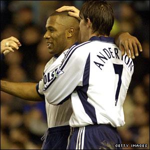 Anderton hugs Tottenham team-mate Les Ferdinand