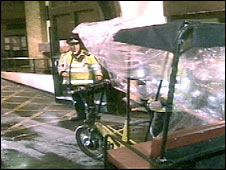 Policeman impounding a modified pedicab