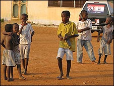 Ghanaian children play in a car park