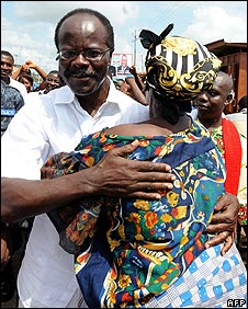 An elderly woman hugs Convention People's Party presidential candidate Kwesi Nduom
