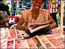 A vendor selling papers in Ghana
