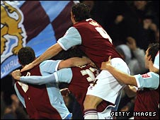 Burnley celebrate their victory over Arsenal in the quarter-finals