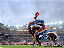 The can-can girls enjoy the atmosphere at the Stade de France