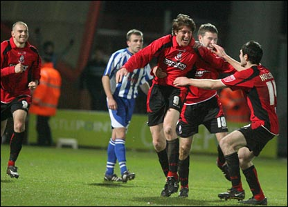 Anderton is mobbed after scoring for Bournemouth (Picture: Mick Cunningham)