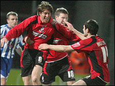 Darren Anderton is mobbed after scoring