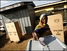 A woman casting her vote at the Victory International polling station in the Kakuudi neighborhood of Accra.