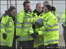 Police remove a Plane Stupid protester