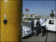 A bullet hole in a traffic light pole in Nisour Square in Baghdad, 7 December 2008