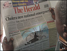 A man reads the Herald newspaper in Harare