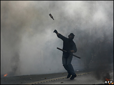 A youth clashes with riot police in Athens on 7 December 2008