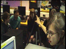Students gatehr round computers to speak to students in Beijing