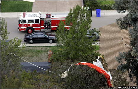The parachute of the jet's pilot, caught in the tree of a nearby home