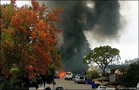 Smoke billows from the crash site