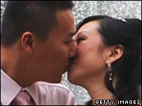 Chinese couple share a kiss