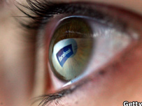 Facebook logo reflected in eye