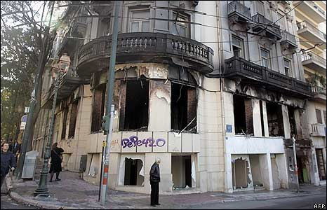 A scorched historic building in Athens by daylight, 9 December