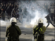 Riot police face protesters in central Athens