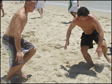 Crusaders captain Jace Van Dijk and Matty Smith enjoy the beach at the Gold Coast