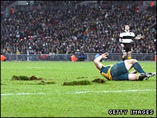 Australian rugby player Matt Dunning lies next to large divots after being injured at Wembley