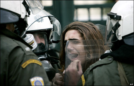 Police arrest a teenager after the funeral in Athens on 9 December 2008