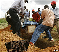 A Zimbabwean family bury a relative who died of cholera