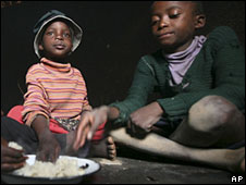 Children eating maize meal in Zimbabwe
