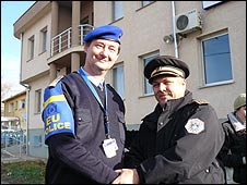 Eulex police officer Imre Pallagi (L) with his local counterpart Popovic Nebojsa in the Serb enclave of Gracanica 9/12/2008