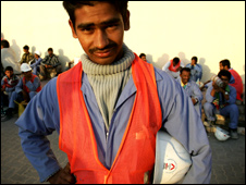 A Pakistani construction worker prepares for a day at work in Dubai