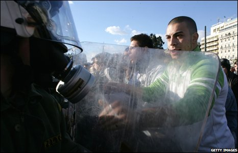 Protesters clash with police during the general strike in Athens, 10 December 2008