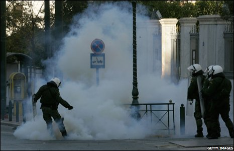 Police amid smoke in Athens during the general strike