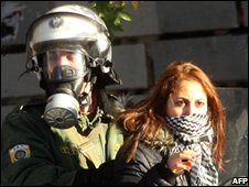 A young woman is arrested during the protests in Athens