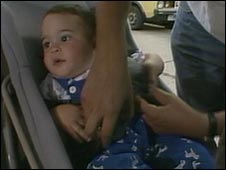 A baby is buckled into a car seat
