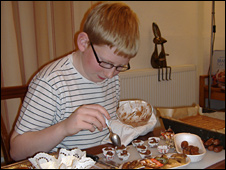 Stephen, 12, making his Christmas chocolates