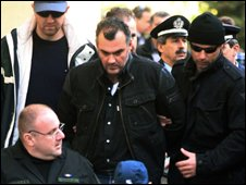 Shooting suspect arrives at the Athens prosecutor's office on 10 December  
