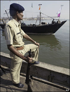 Policeman guarding coastline in Gujarat, India